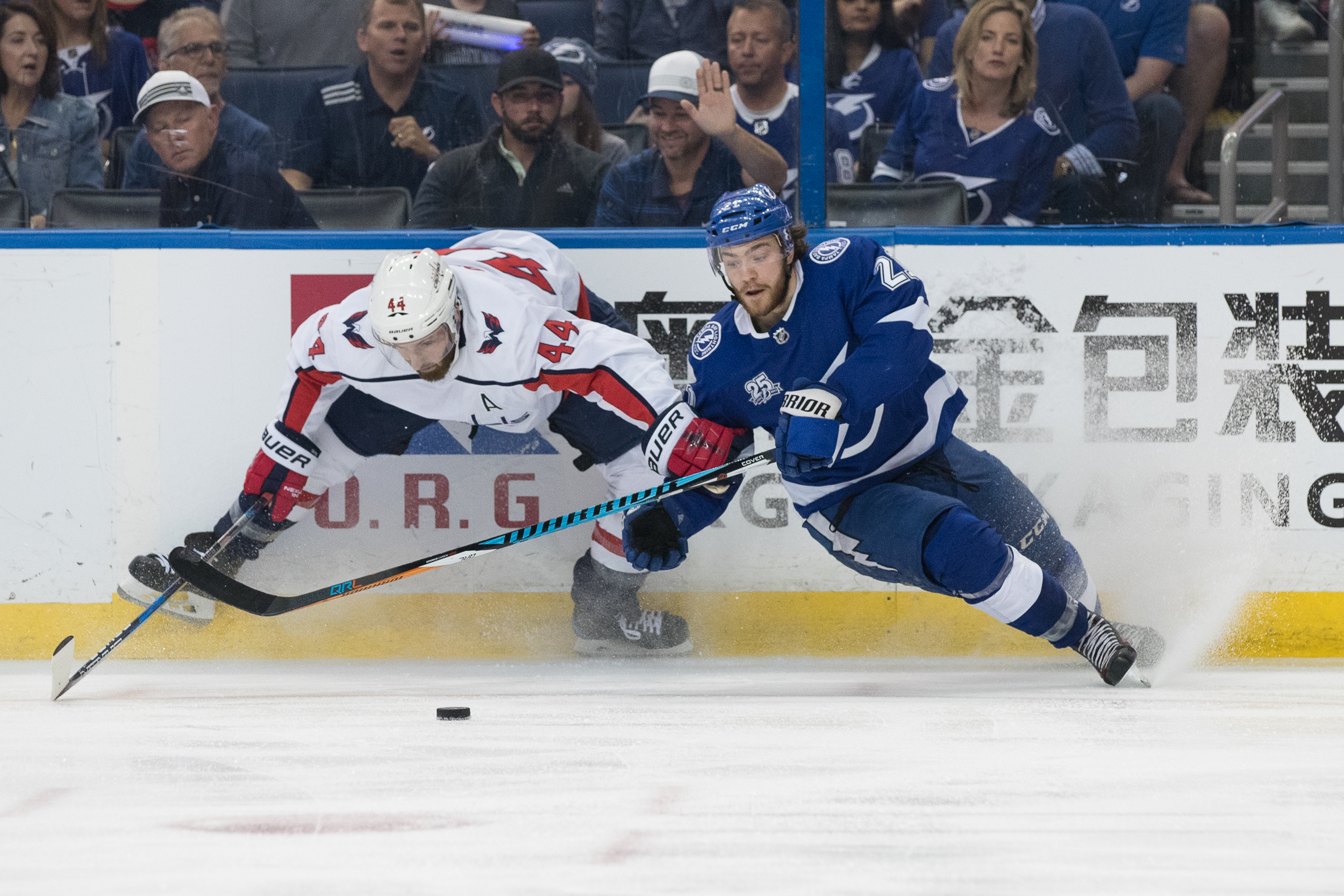 Brayden Point and Opik slip while trying to get to the puck./STEVEN MUNCIE