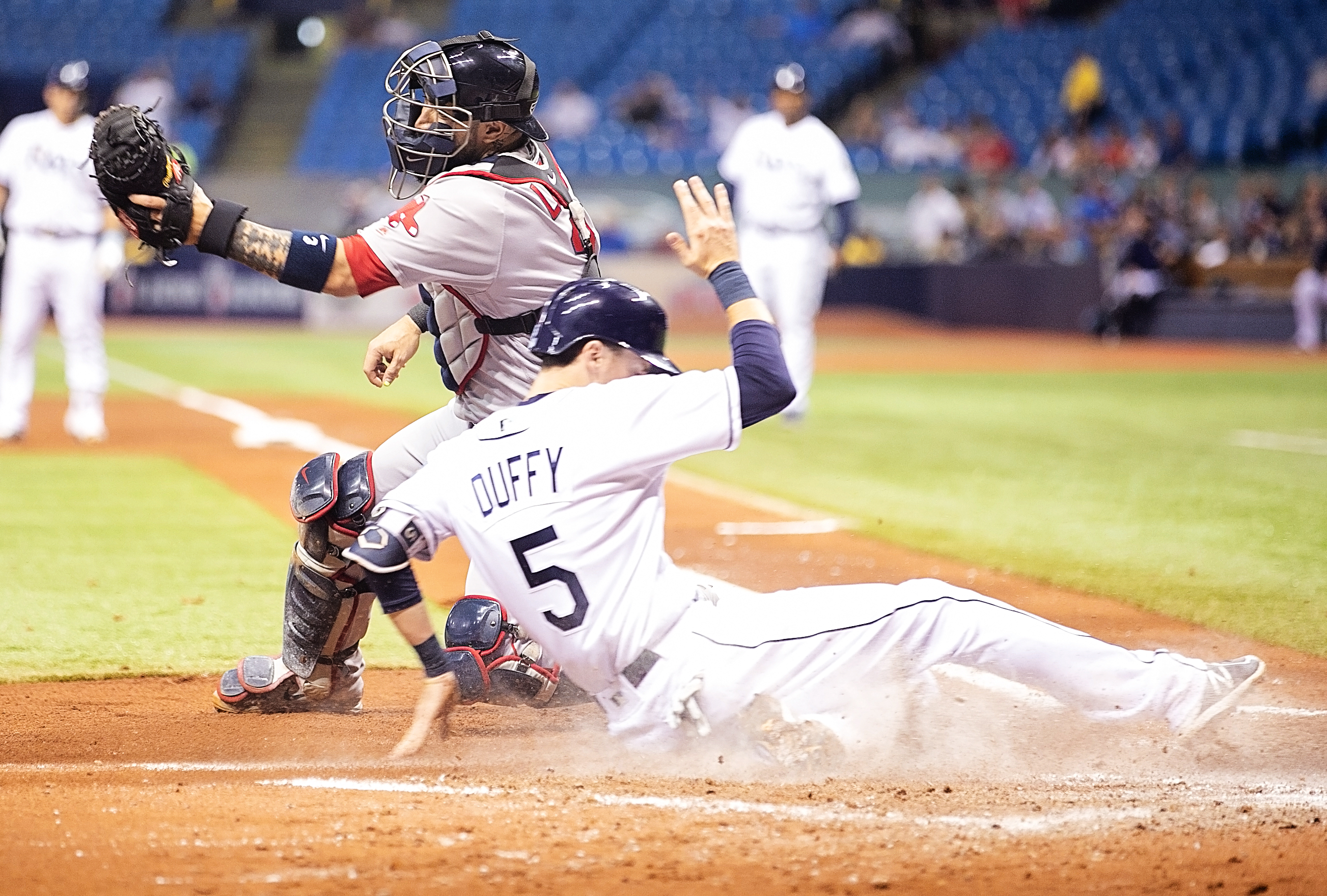 Duffy sneaks in for another Rays' run./CARMEN MANDATO
