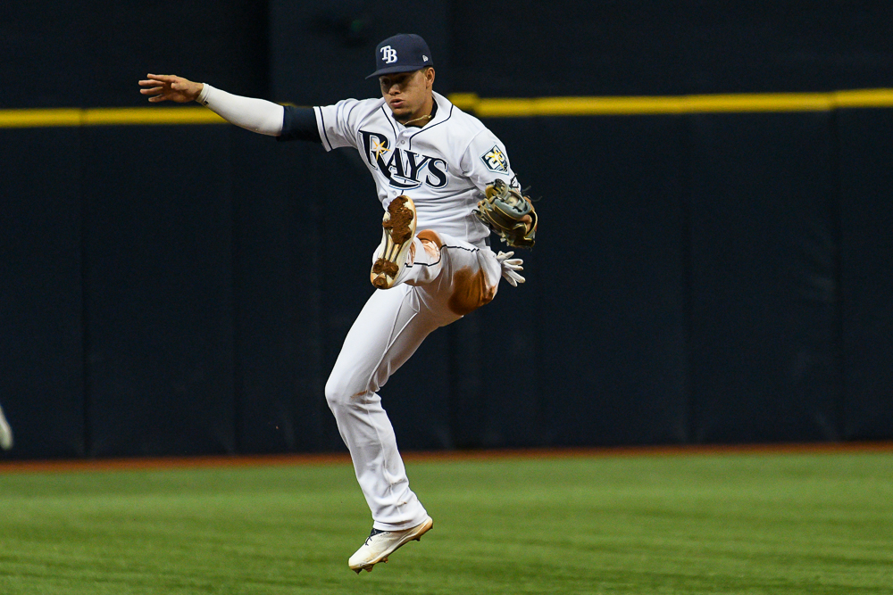 Willy Adames makes a leaping stop against the Yankees./JAMES LUEDDE