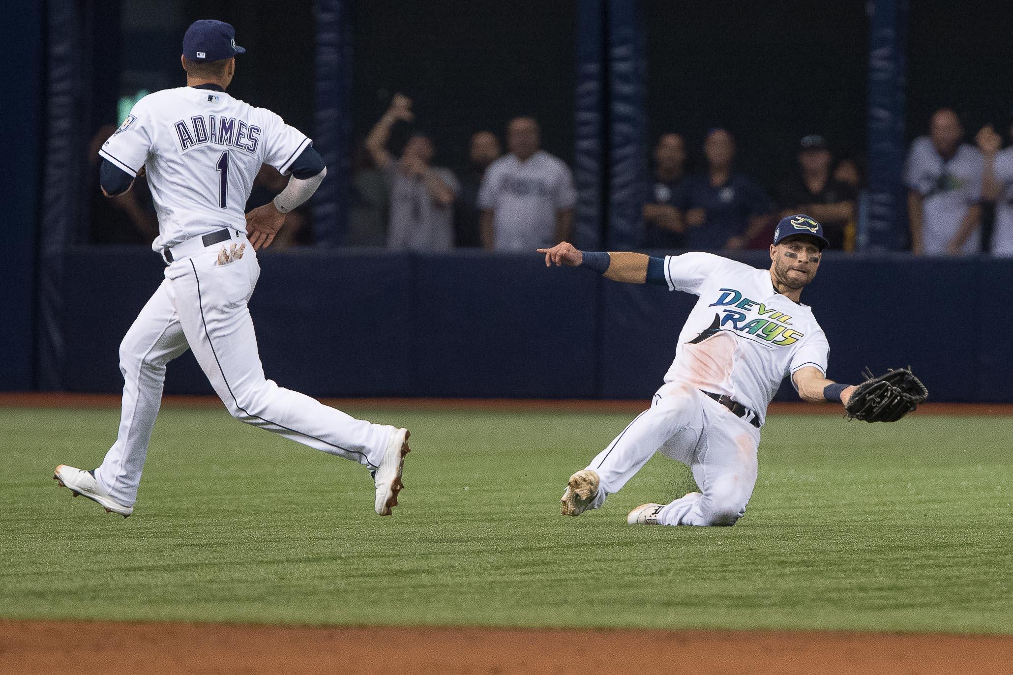 Kiermaier makes a sliding catch for the Rays.//STEVEN MUNCIE