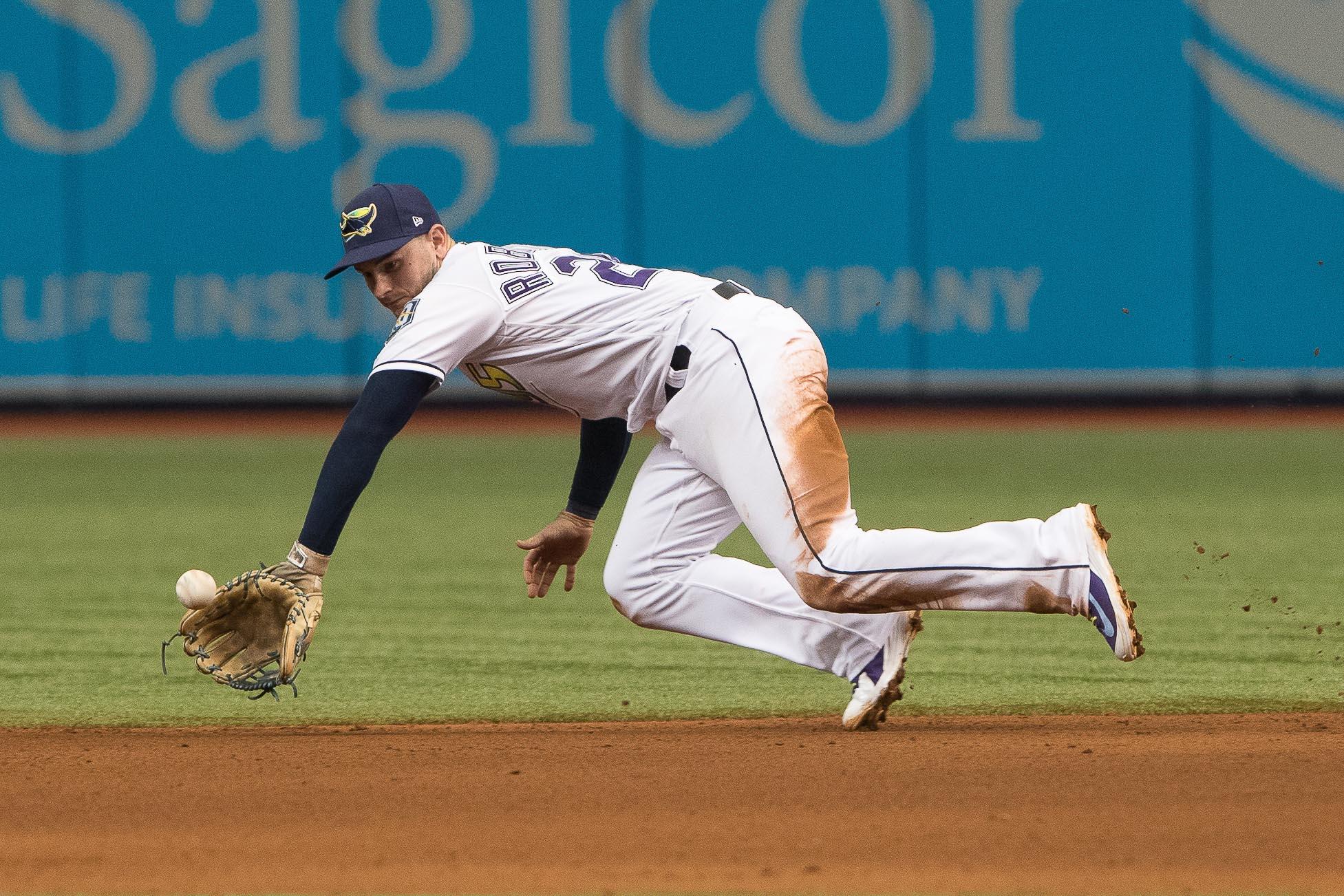 Daniel Robertson gets low for the catch./STEVEN MUNCIE