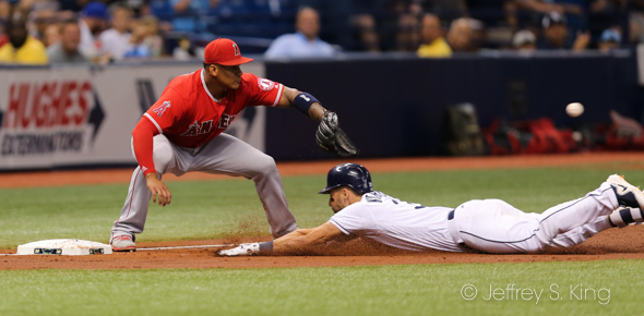 Kiermaier slides in with a triple for the Rays./JEFFREY S. KING