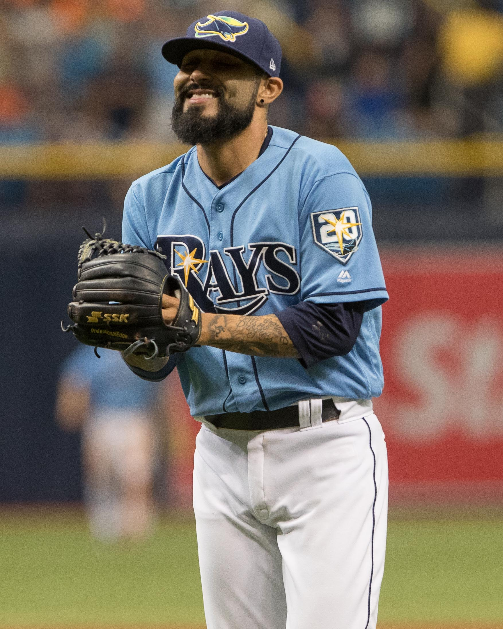 Romo smiles after getting his eighth save./STEVEN MUNCIE