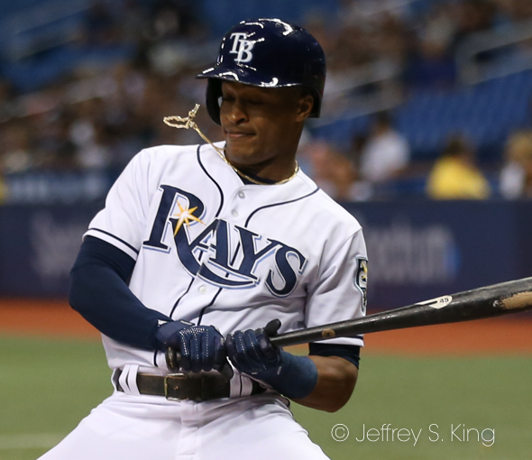 The pitch is a lottle tight for Mallex Smith./JEFFREY S. KING