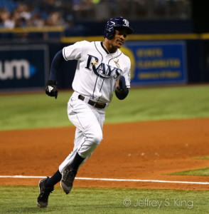Smith rounds third to score a Rays' run./JEFFREY S. KING