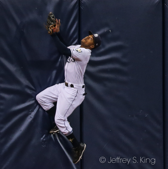 Smith tries to catch up to Tim Beckham's home run./JEFFREY S. KING