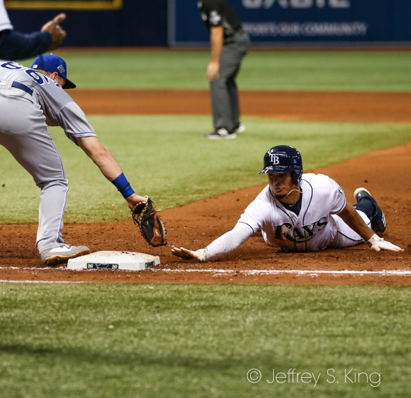 Adames, diving back to first, has been hot at the plate./JEFFREY S. KING