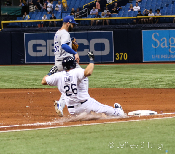 Choi slides into first for an infield single./JEFFREY S. KING