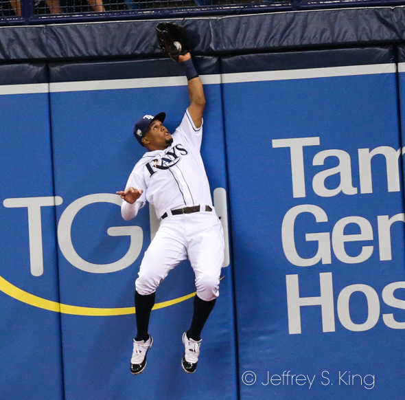 Gomez leaps to make the catch./JEFFREY S. KING