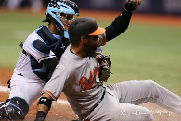 Perez tags a runner out at home./JEFFREY S. KING