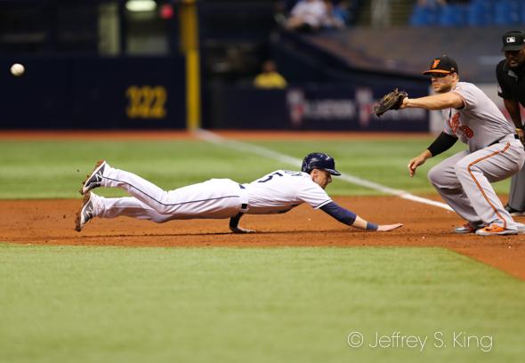 Matt Duffy dives back into first base./JEFFREY S. KING