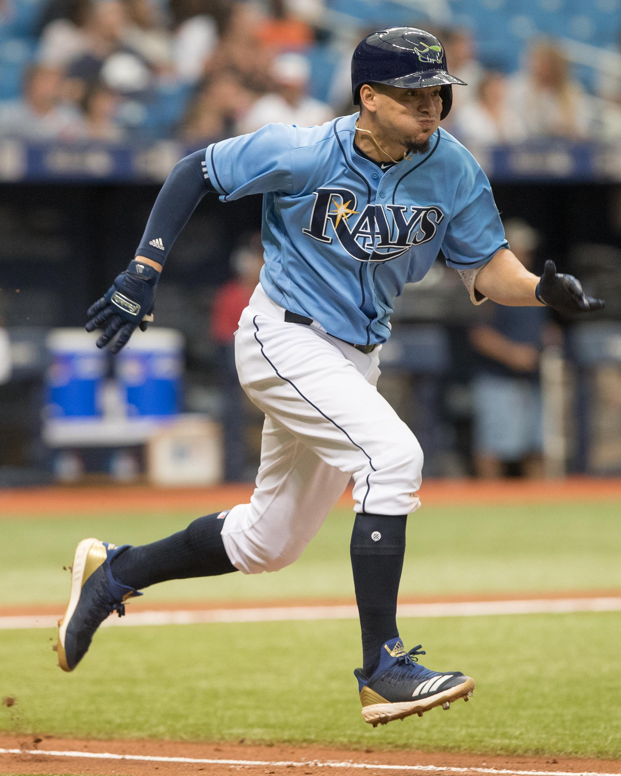 Gomez runs down the first-base line./STEVEM MUNCIE
